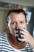 Polish woman age 34 enjoying a soothing cup of coffee. Zawady Central Poland