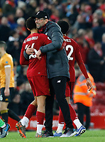 Football - 2019 / 2020 Premier League - Liverpool vs. Wolverhampton Wanderers<br /> <br /> Liverpool manager Jurgen Klopp celebrates with Trent Alexander-Arnold in front of the Kop after his side gains a 1-0 win, at Anfield.<br /> <br /> COLORSPORT/ALAN MARTIN