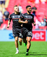 Lincoln City's Harry Anderson, left, and Liam Bridcutt during the pre-match warm-up<br /> <br /> Photographer Andrew Vaughan/CameraSport<br /> <br /> The EFL Sky Bet League One Play-Off Final - Blackpool v Lincoln City - Sunday 30th May 2021 - Wembley Stadium - London<br /> <br /> World Copyright © 2021 CameraSport. All rights reserved. 43 Linden Ave. Countesthorpe. Leicester. England. LE8 5PG - Tel: +44 (0) 116 277 4147 - admin@camerasport.com - www.camerasport.com