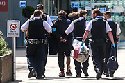 Police assisted by St Thomas' Hospital security personnel arrested a person for medical reasons on Tuesday, May 5, 2020. Whilst a few European countries relax the COVID-19 lockdown, Britain still remains under lockdown without an exit strategy yet. (Photo/Vudi Xhymshiti)