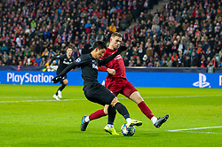 SALZBURG, AUSTRIA - Tuesday, December 10, 2019: Liverpool's captain Jordan Henderson (R) and FC Salzburg's Hee-Chan Hwang during the final UEFA Champions League Group E match between FC Salzburg and Liverpool FC at the Red Bull Arena. (Pic by David Rawcliffe/Propaganda)