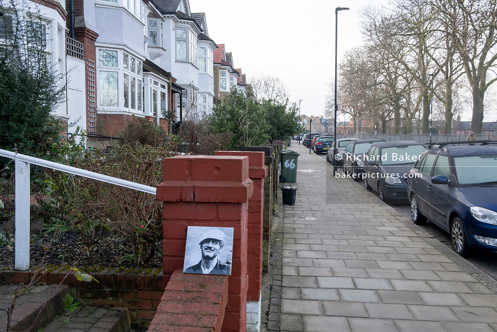 A discarded print of ex-Hollywood star, Paul Newman, is propped against a wall outside a residential home in Herne Hill, south London, on 23rd January 2021, in London, England.
