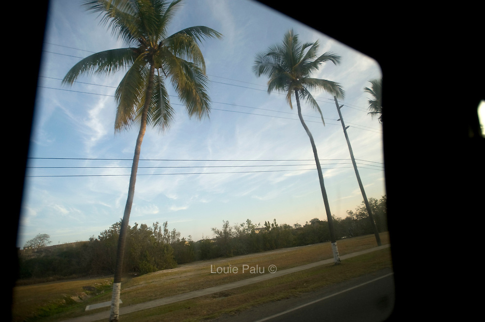 A view of palm trees out of vehicle driving through the Guantánamo Bay Naval Station, where the Guantanamo Bay Detention Facility is located in Guantanamo Bay, Cuba. The detainees held in this facility were captured after the attacks on the United States on September 11, 2001. In 2009 US president Barack Obama ordered the closure of the facility, yet to date it still remains open. These Photos were reviewed by military officials before release.