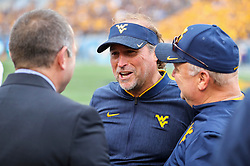 Sep 22, 2018; Morgantown, WV, USA; West Virginia Mountaineers head coach Dana Holgorsen smiles along the sidelines during the fourth quarter against the Kansas State Wildcats at Mountaineer Field at Milan Puskar Stadium. Mandatory Credit: Ben Queen-USA TODAY Sports