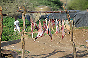 Chunks of meat hung out to dry on hooks in the northwestern town of Opuwo, Namibia.