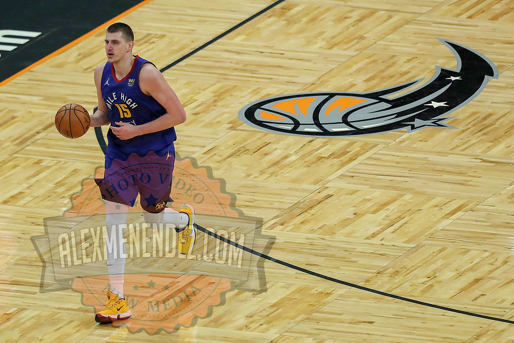 ORLANDO, FL - MARCH 23:  Nikola Jokic #15 of the Denver Nuggets controls the ball against the Orlando Magic at Amway Center on March 23, 2021 in Orlando, Florida. NOTE TO USER: User expressly acknowledges and agrees that, by downloading and or using this photograph, User is consenting to the terms and conditions of the Getty Images License Agreement. (Photo by Alex Menendez/Getty Images)*** Local Caption *** Nikola Jokic