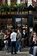 People outside the White Lion pub. Covent Garden in the West End of London.