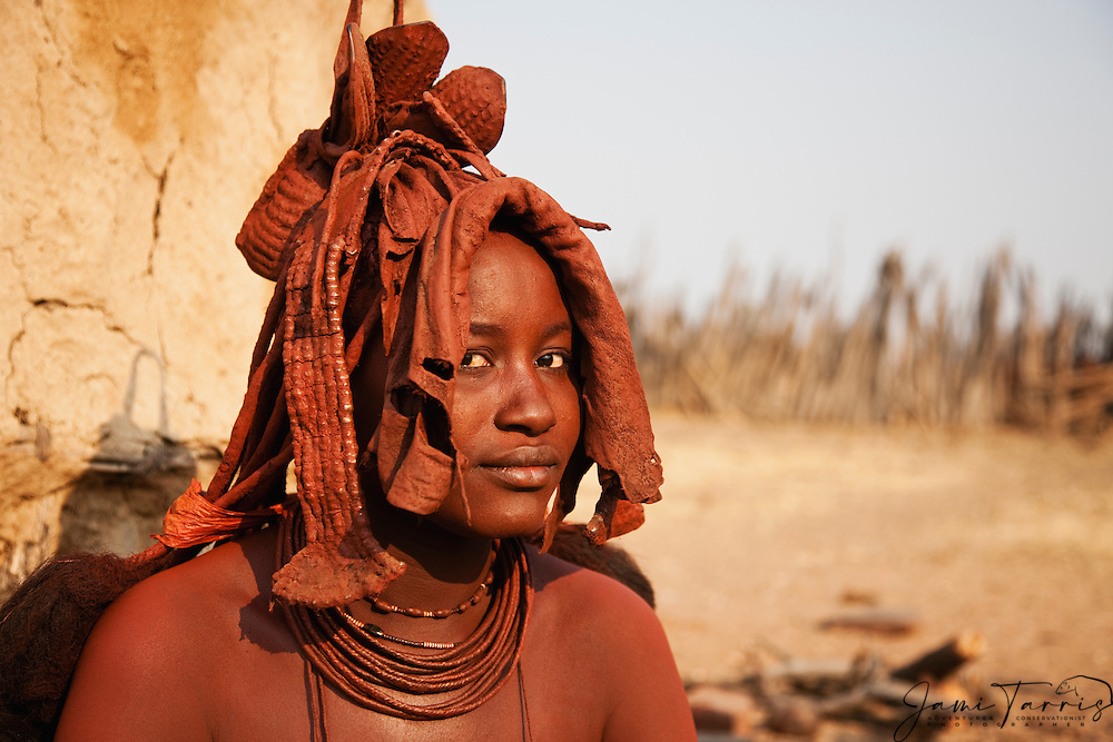 A portrait of a traditional Himba girl in her village ,Kaokoland, Namibia,Africa