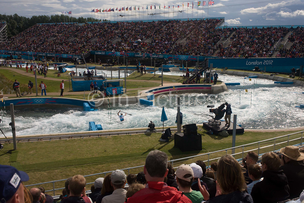 Wide view of the canoe slalom at the Lee Valley White Water Centre, north east London, on day 3 of the London 2012 Olympic Games. The Lee Valley White Water Centre is located 30 kilometres north of the Olympic Park, on the edge of the 1,000-acre River Lee Country Park – part of the Lee Valley Regional Park. The centre has two separate courses: a 300 metre Olympic-standard competition course with a 5.5m descent, and a 160m intermediate/training course with a 1.6m descent. Whitewater course specialists Whitewater Parks International, working with civil and structural engineers Cundall, are the designers of the whitewater courses.