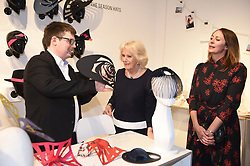 The Duchess of Cornwall (centre) chats with designer Paul Stafford (left) and Chief Executive of the British Fashion Council Caroline Rush during a visit to London Fashion Week at the BFC Show Space, London.