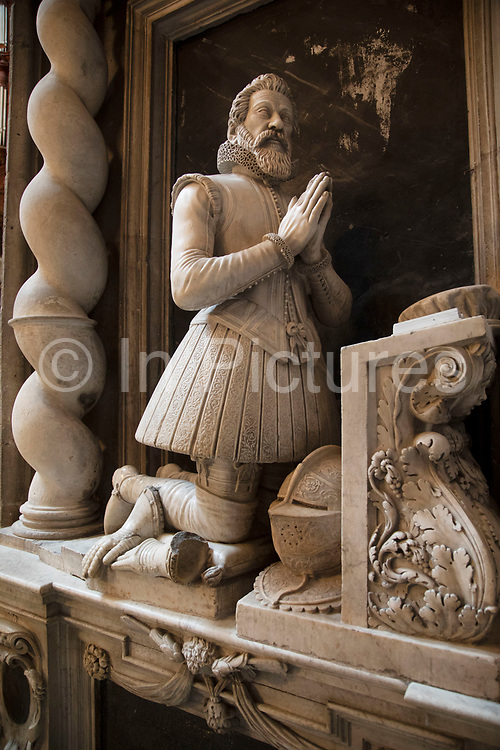Interior stone carving of a kneeling knight in Narbonne Cathedral in Narbonne, France. Cathedrale Saint-Just-et-Saint-Pasteur de Narbonne, is a Gothic style Roman Catholic church located in the town of Narbonne, France. The cathedral is a national monument and dedicated to Saints Justus and Pastor.