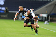 Eli Walker of the Ospreys evades a tackle from Andrew Trimble of Ulster.  Guinness Pro12 rugby match, Ospreys v Ulster Rugby at the Liberty Stadium in Swansea, South Wales on Saturday 7th May 2016.<br /> pic by  Andrew Orchard, Andrew Orchard sports photography.