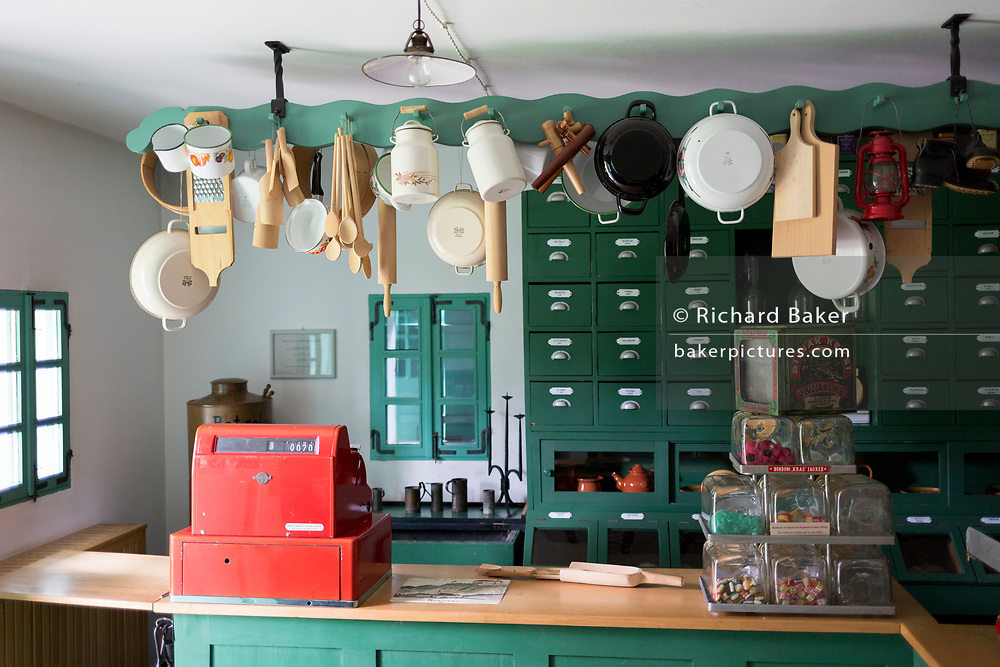 Interior of the Grocer's shop at the Rogatec Open Air Museum, very close to the Croatian border, on 24th June 2018, in Rogatec, Slovenia. The museum of relocated and restored 19th and early 20th century farming buildings and houses represents folk architecture in the area south of the Donacka Gora and Boc mountains.