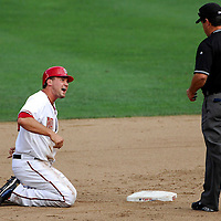 21 July 2007:  Washington Nationals third baseman Ryan Zimmerman (11) yells at second base umpire Rob Drake after being called out on a pick off play at second base in the 6th inning.  The Nationals defeated the Rockies 3-0 at RFK Stadium in Washington, D.C.  ****For Editorial Use Only****