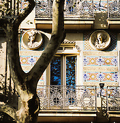 Architectural detail of Azulejos, ceramic tiling, on a building in the famous La Rambla street in Barcelona, Spain