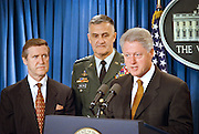 President Bill Clinton makes a statement on the Kosovo peace agreement and thanks NATO and US Forces for their efforts as Defense Secretary William Cohen (L) and Joint Chief of Staff General Hugh Shelton look on in the White House briefing room June 10, 1999 in Washington, DC.
