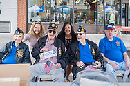 Merrick, New York, USA. September 9, 2017.  LAURA GILLEN, Democratic candidate for Town of Hempstead Supervisor, and SYLVIA CABANA, Democratic candidate for Town of Hempstead Clerk, pose with members of American Legion Merrick Post 1282, at the Merrick Fall Festival and Street Fair.