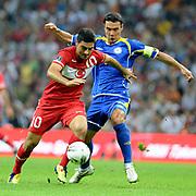 Turkey's Mehmet EKICI (L) during their UEFA EURO 2012 Qualifying round Group A soccer match Turkey betwen Kazakhstan at TT Arena Istanbul September 02, 2011. Photo by TURKPIX