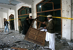 Pakistani security officials inspect the suicide blast site in northwest Pakistan's Peshawar on Feb. 13, 2015. At least 19 people were killed and over 40 others injured in a twin suicide attack at a mosque of Shia Muslims in Pakistan's northwestern provincial capital of Peshawar Friday afternoon, officials said. EXPA Pictures © 2015, PhotoCredit: EXPA/ Photoshot/ Ahmad Sidique<br /> <br /> *****ATTENTION - for AUT, SLO, CRO, SRB, BIH, MAZ only*****