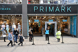 As England eases out of Coronavirus lockdown no 3, non-essential shops reopen on 12 April 2021. Queueing to get into Primark, Norwich UK