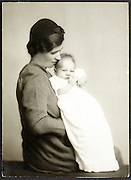 mother holding her new born baby 1930s