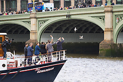 London Bridge, London, June 15th 2016. A flotilla of fishing boats led by UKIP's Nigel Farage heads through Tower Bridge in protest against the EU's Common Fisheries Policy and in support of Britain leaving the EU. PICTURED: Farage, in the bow of his boat waves at supporters on Westminster Bridge.