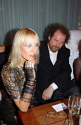Left & centre VIRGINIA BATES and MIKE FIGGIS at a party at The Sanderson Hotel, Bernnnnners Street, London in aid of Sargent Cancer Care for Children on 7th July 2004.
