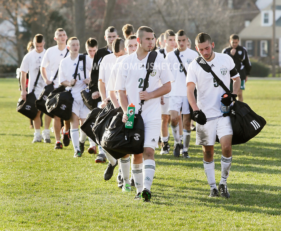Middletown, New York - Chazy High School soccer players walk off the field after losing to Hamilton in the New York State Class D boys' soccer championship game on Nov. 20, 2011.