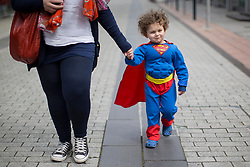 © licensed to London News Pictures. London, UK 28/04/2013. Leon Yianni, a 3-year old dressed as Superman, attending to Sci-Fi Parade with her mother in Stratford, London on Sunday, 28 April 2013. Photo credit: Tolga Akmen/LNP