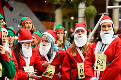 © Licensed to London News Pictures. 07/12/2019. LONDON, UK.  7 December 2019.  Participants prepare to take part in The 39th Great Christmas Pudding Race in Covent Garden, raising funds for Cancer Research as well as having lots of festive fun.  Photo credit: Stephen Chung/LNP