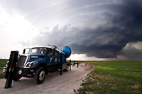 A radar truck with Project Vortex 2 scans a storm near Dodge City, Kansas, June 9, 2009.   Project Vortex 2 is a two year National Science Foundation and NOAA funded science mission to study tornadoes and supercell thunderstorms.