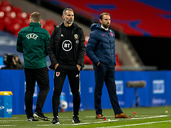 LONDON, ENGLAND - Thursday, October 8, 2020: Wales' manager Ryan Giggs (L) and England's manager Gareth Southgate during the International Friendly match between England and Wales at Wembley Stadium. The game was played behind closed doors due to the UK Government's social distancing laws prohibiting supporters from attending events inside stadiums as a result of the Coronavirus Pandemic. England won 3-0. (Pic by David Rawcliffe/Propaganda)
