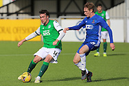 Stevie Mallan (14) of Hibernian battles with Cove Rangers Blair Yule (8) during the Betfred Scottish League Cup match between Cove Rangers and Hibernian at Balmoral Stadium, Aberdeen, Scotland on 10 October 2020.