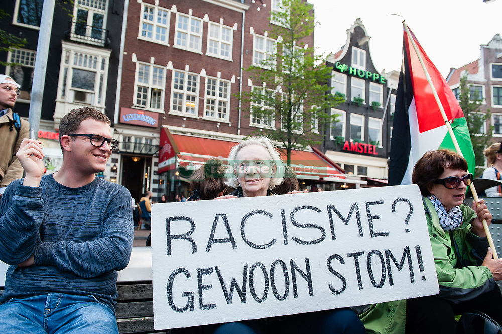 August 17, 2017 - Amsterdam, Netherlands - Demonstrators march with a banner during a protest called by the Dutch Antifascist Action AFA (Anti Fascistische Actie) against the violence that took place at the August 12th 'Unite the Right' rally in Charlottesville, at Spui Square in Amsterdam, Netherlands on August 17, 2017.  Last Saturday, a neo-nazi drove his car into an anti-fascist protest against one of the biggest nazi demonstrations in the USA, which took place on the same day. This resulted in multiple serious injuries and the death of 32 year old Heather Heyer. With this demonstration that was organized by AFA Nederland, people in The Netherlands wanted to show their support to all the anti-fascist victims and with the relatives of Heather Heyer. The demonstration passed in front of the American embassy situated in the Museumplein, Amsterdam. (Credit Image: © Romy Arroyo Fernandez/NurPhoto via ZUMA Press)