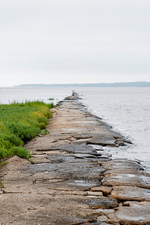 """""""The Rocks"""" - a jetty built by the Army Corps of Engineers in 1883 - extends out from Kure Beach, North Carolina on Sunday, August 8, 2021. Copyright 2021 Jason Barnette"""