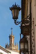 View of church with street lamp in foreground, Ronda, Andalusia, Spain