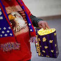 """A Vietnam veteran walks back to his set with popcorn before a """"Thank You Tour 2016"""" rally for the President-elect Donald J. Trump December 15, 2016 at Giant Center in Hershey, Pennsylvania."""