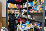 Volunteers packing food orders of tins and drinks at a central food bank, in a church in Dysart, near Kirkcaldy. Items are made ready to go out to local community centres. Some years ago they would only be giving out a few hundred parcels per month, nowadays its nearer a thousand<br /><br />Kirkcaldy is one of the poorest areas in Scotland with staggeringly high numbers of child poverty. Many disadvantaged families, and vulnerable people, and over a thousand children are surviving below the breadline in Kirkaldy East, that is 40%. Voluntary organisations and foodbanks give over a thousand food parcels a month, several times more than a few years ago. The Conservative government's policy of austerity together with the new 'Universal Credit' system which replaced six other benefits, makes millions of people poorer, many hundreds of thousands on the poverty line or below. Whilst people overall voted strongly against Brexit in Scotland, in other parts of the country, poorer constituencies voted largely for Brexit, in a vote against the City of London.
