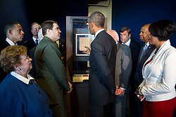 """President Barack Obama views the original manuscript of  """"The Star-Spangled Banner"""" during his tour of the Fort McHenry Visitor and Education Center in Baltimore, Md., Sept. 12, 2014. With the President are Vince Vaise,  National Parks Service Ranger and Chief of Interpretation at Fort McHenry, and Maryland elected officials. (Official White House Photo by Pete Souza)<br /> <br /> This official White House photograph is being made available only for publication by news organizations and/or for personal use printing by the subject(s) of the photograph. The photograph may not be manipulated in any way and may not be used in commercial or political materials, advertisements, emails, products, promotions that in any way suggests approval or endorsement of the President, the First Family, or the White House."""