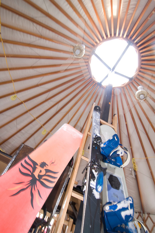 Skis and snowboards rest on the center pole of the Hostel yurt at Mount Bohemia ski resort in Michigans Upper Peninsula.