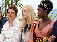 Director Alice Rohrwacher, Elle Fanning, and Maimouna N'Diaye at the  Jury photo call at the 72nd Cannes Film Festival, Tuesday 14th May 2019, Cannes, France. Photo credit: Doreen Kennedy