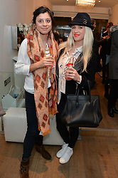 Left to right, ZARA KABA and actress SCARLETT BOWMAN at a Valentine's charity event to raise heart awareness and support the charity Arrhythmia Alliance held at Sophie Gass, 4 Ladbroke Grove, London on 13th February 2014.