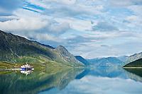 Passenger ferry boat travel from Gjendesheim towards Memurubu on Lake Gjende, Jotunheimen national park, Norway