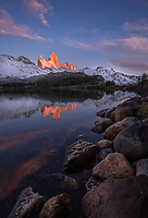 Fitz Roy reflecting in the sunrise light and calm waters of Laguna Capri, Los Glaciares National Park, Argentina