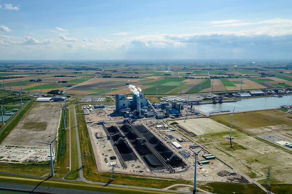 Nederland, Groningen, Eemshaven, 05-08-2014; Haven omzoomd door windmolens. Energie-landschap met elektricitieitscentrale, de RWE-Essent elektriciteitscentrale ( kolencentrale).<br /> Harbor area and energy landscape with wind turbines and  the coal fired  RWE-Essent power plant.<br /> luchtfoto (toeslag op standard tarieven);<br /> aerial photo (additional fee required);<br /> copyright foto/photo Siebe Swart