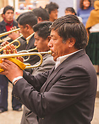 Trumpeter in a procession in La Paz