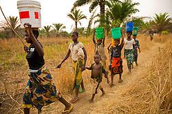 Girls come back from carrying water form Lake Tanganyika to their village of Nkonkwa, on Lake Tanganyika in Tanzania.