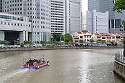 Tour boat cruises down the Singapore River, Singapore