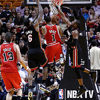 06 March 2011: Chicago Bulls point guard Derrick Rose (1) goes to the basket past Miami Heat small forward LeBron James (6) and Miami Heat shooting guard Dwyane Wade (3) during the Chicago Bulls 87-86 victory over the Miami Heat at the AmericanAirlines Arena, Miami, Florida, USA.