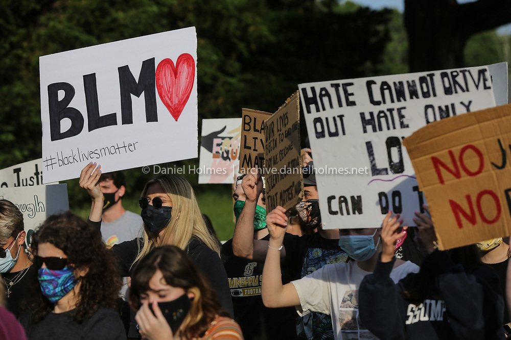 (6/3/20, HOPEDALE, MA) Marchers hold signs during a Black Lives Matter march in Hopedale on Wednesday. [Daily News and Wicked Local Photo/Dan Holmes]